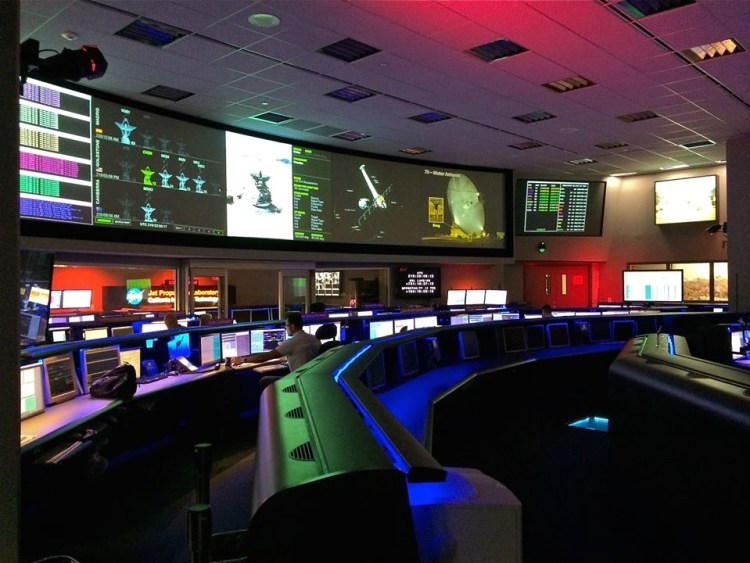 The Control Room at JPL where scientists transmit and receive messages to rovers and satellites exploring other worlds via a global network of radio antennae: the Deep Space Network. Kind of looks like where I work.