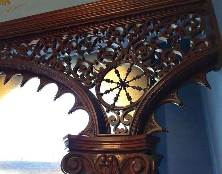 Hand-carved wooden columns frame a window in one of the rooms of the recently renovated Brand Library.