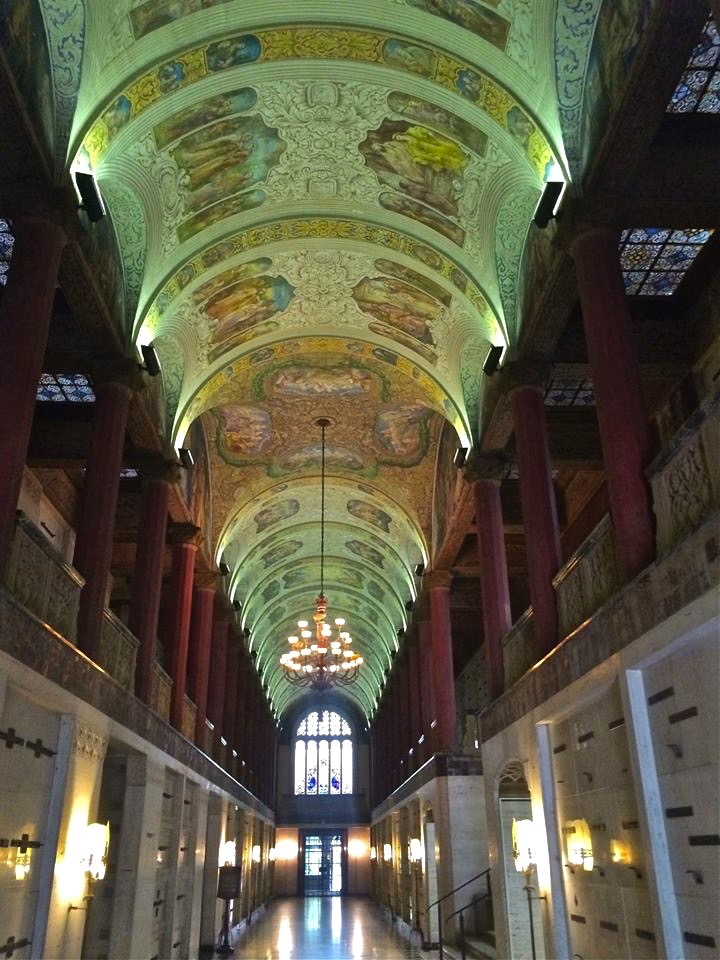 Inside, the building has marble fronted crypts and floors and magnificent stained glass ceilings.