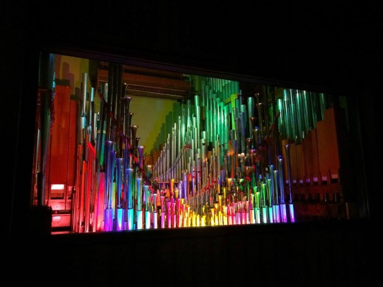 As the Mighty Wurlitzer rises out of the floor on its platform, the wood-paneled walls open up, revealing the glass-encased pipes inside, lit in a rainbow of colors.