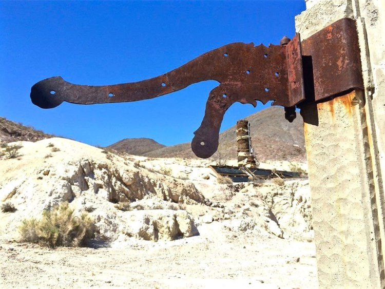 A 1930's solar hot water heater, much larger than today's solar water heaters, is near the main house, and a large stock of railroad ties salvaged from the Tonopah and Tidewater Railroad is also strewn around the property.