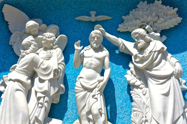 Blue & white bas-relief sculpture of Christ being baptized.