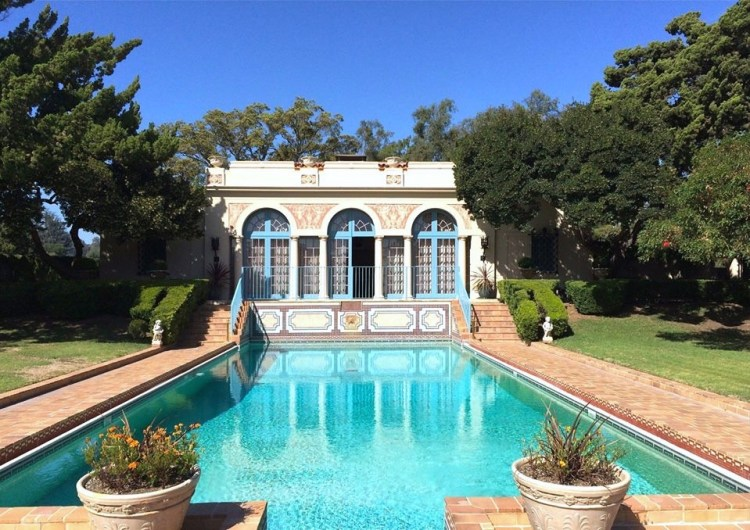 Today, it is listed on the National Register of Historic Places and is open by appointment to the public. Located behind the iconic Beverly Hills Hotel, the beautiful six-acre property contains a breathtaking display garden, mansion and pool pavilion.