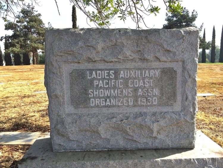 "Ladies Auxiliary Pacific Coast Showmen's Association Monument represents the women circus freaks who entertained the masses. Over 400 carnival workers and performers are buried here. The area is referred to as ""Showmen's Rest."""