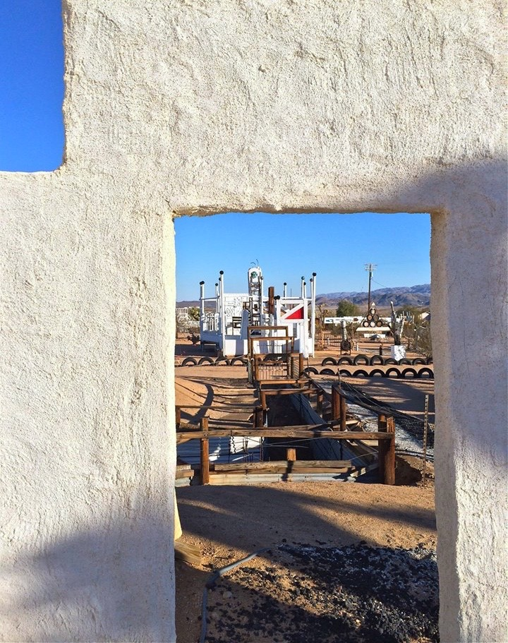 Noah Purifoy was no stranger to the themes of resistance and change. Before moving to the desert he served as the founding director of the Watts Towers in nearby Los Angeles, where he witnessed firsthand the Watts Riots of the 1960s. After the riots subsided, Purifoy took to the streets and collected debris, such as broken furniture and melted neon signs, and channeled his anger and bitterness into a collaborative art piece.