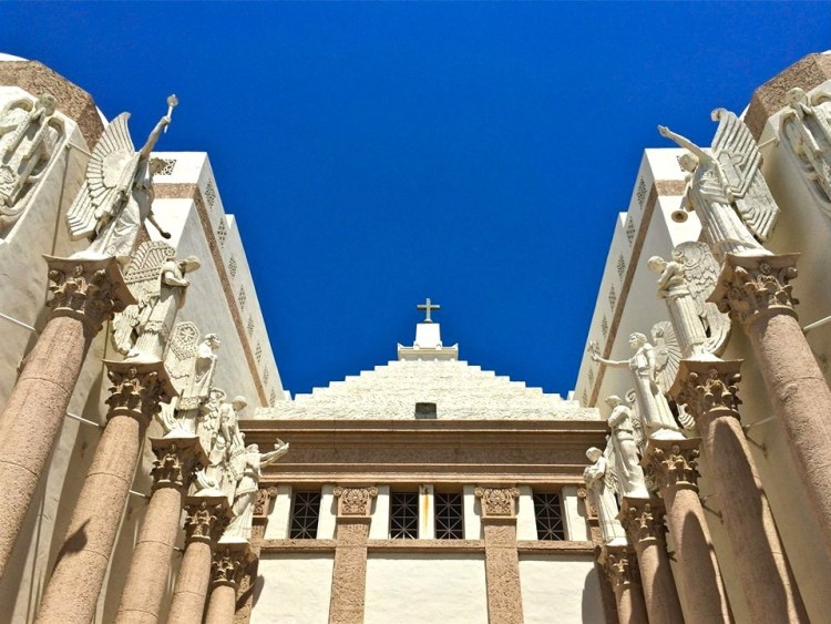 crown jewel is the Italian Romanesque Revival chapel, which comes complete with a dramatic angel-lined entry court that would have done Cecil B De Mille proud.