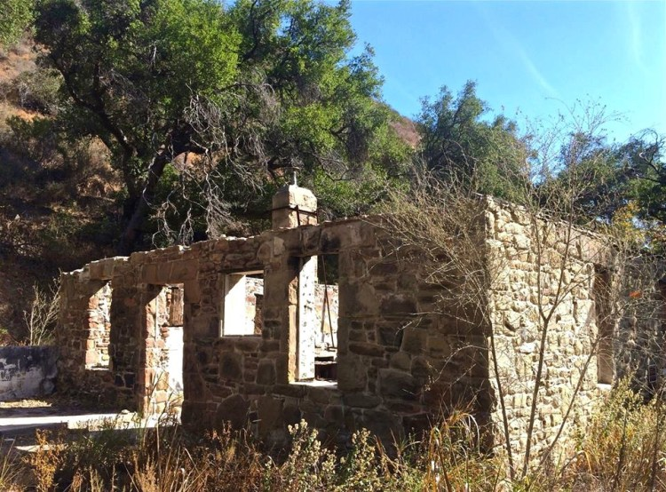 Located off Corral Canyon Road from Pacific Coast Highway, the canyon runs north-to-south about a mile east of Point Dume. Around 1865, Matthew Keller built a stone cottage in the canyon, believed to be the oldest existing stone building in Malibu. After surviving countless wildfires, the structure was finally left in ruins by the 2007 Corral Canyon Fire.