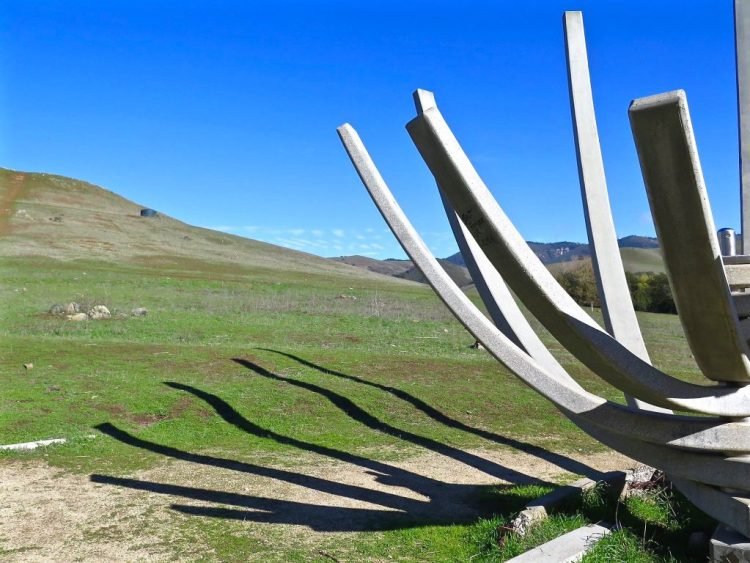 "The ""Thin Blade Structure"" was built in 2008, and was inspired by the similar looking ""Concrete Flower"" sculpture from 1964. The Concrete Flower sculpture has collapsed, likely due to improper tensioning in the steel support cables inside the structure, Saliklis said. The Thin Blade Structure showcases consulting engineer Mark Haselton's skill at prestressing concrete. Inside the concrete arms are cables stressed with thousands of pounds of pressure, that keep the concrete around it from breaking."