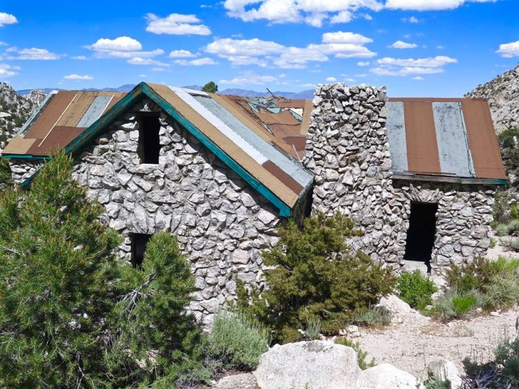 The 2000 square foot building would be made of natural stone from the surrounding area and cement which was carried in on burros and mixed daily.