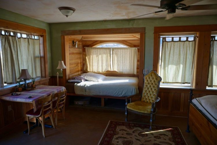 Our $110 a night cabin included geothermally heated floors, a large picture window, two comfy queen size beds, a kitchen, bathroom, 24-hour access to the bath house/outdoor rock pools and a fire pit. What a deal.