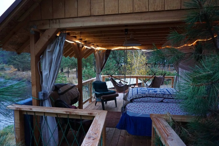 "12x18 ""High Deck"" is attached to the treehouse by a little bridge leading to the swinging/floating queen air mattress. Fall asleep to the bubbling stream"