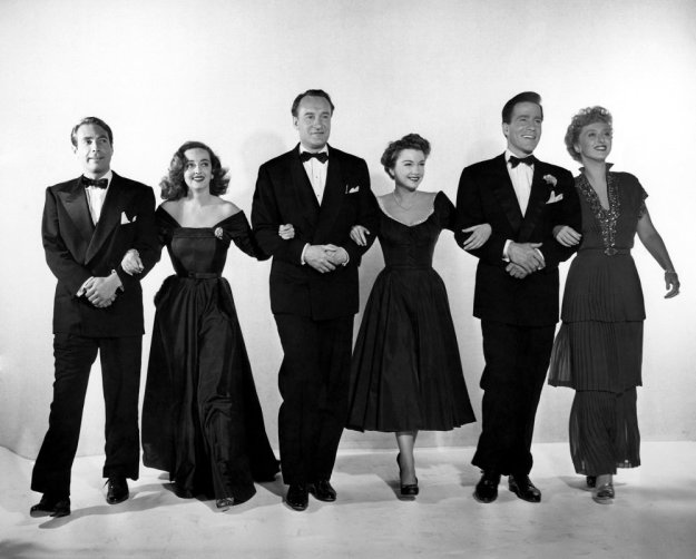 The cast of 'All About Eve' - Gary Merrill, Bette Davis, George Sanders, Anne Baxter, Hugh Marlowe, and Celeste Holm.