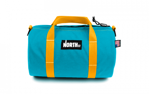 product-duffle-small-teal-gold_a0629ca0-c816-48eb-8182-b28ae8b034d2
