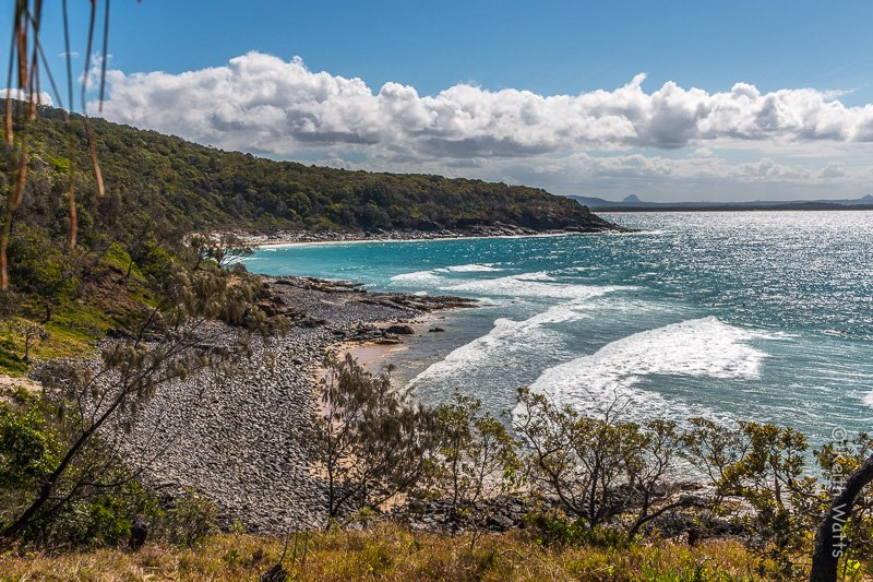 Halfway between Noosa Heads and A Bay lies Granite Bay. Popular with surfers catching waves from the point