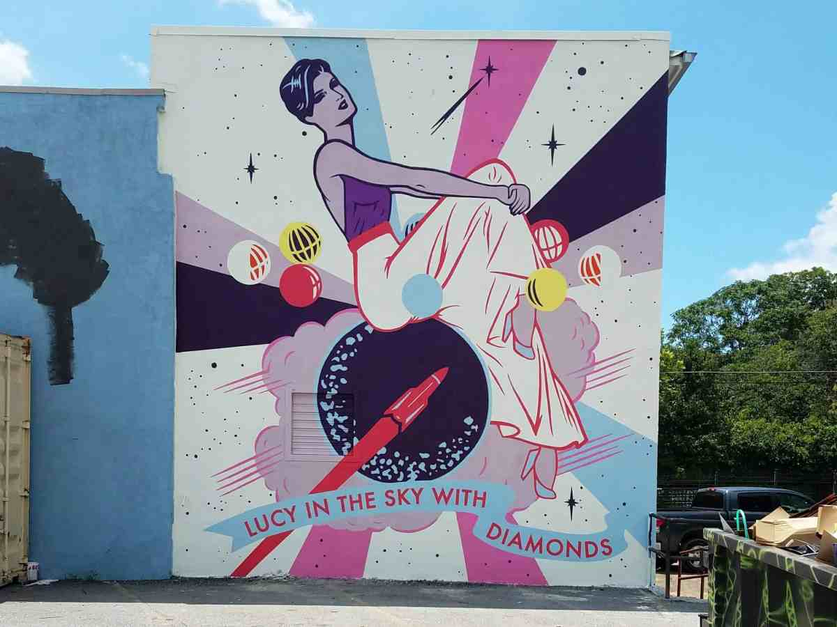 Mural by artist Tommy Bronx featuring a woman sitting on a rocket in Old Forth Ward Atlanta