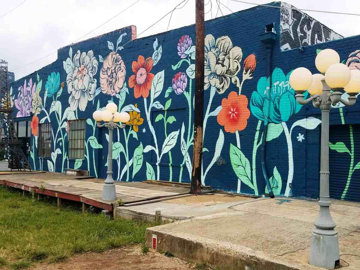 Building facade featurig large flowers by artist Ouizi in Midtown Atlanta
