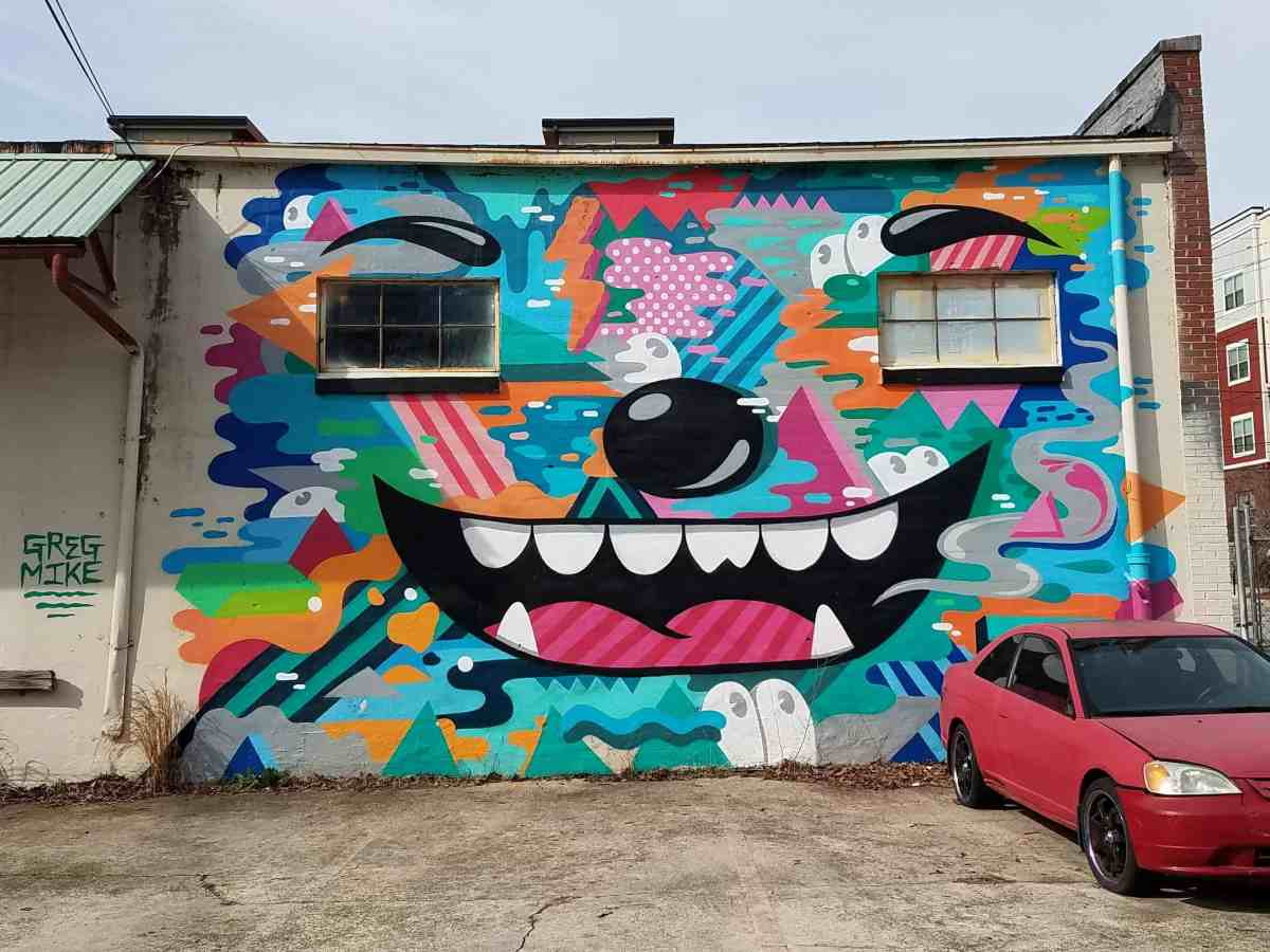 Mural of a face with windows for eyes by artist Greg Mike in Inman Park