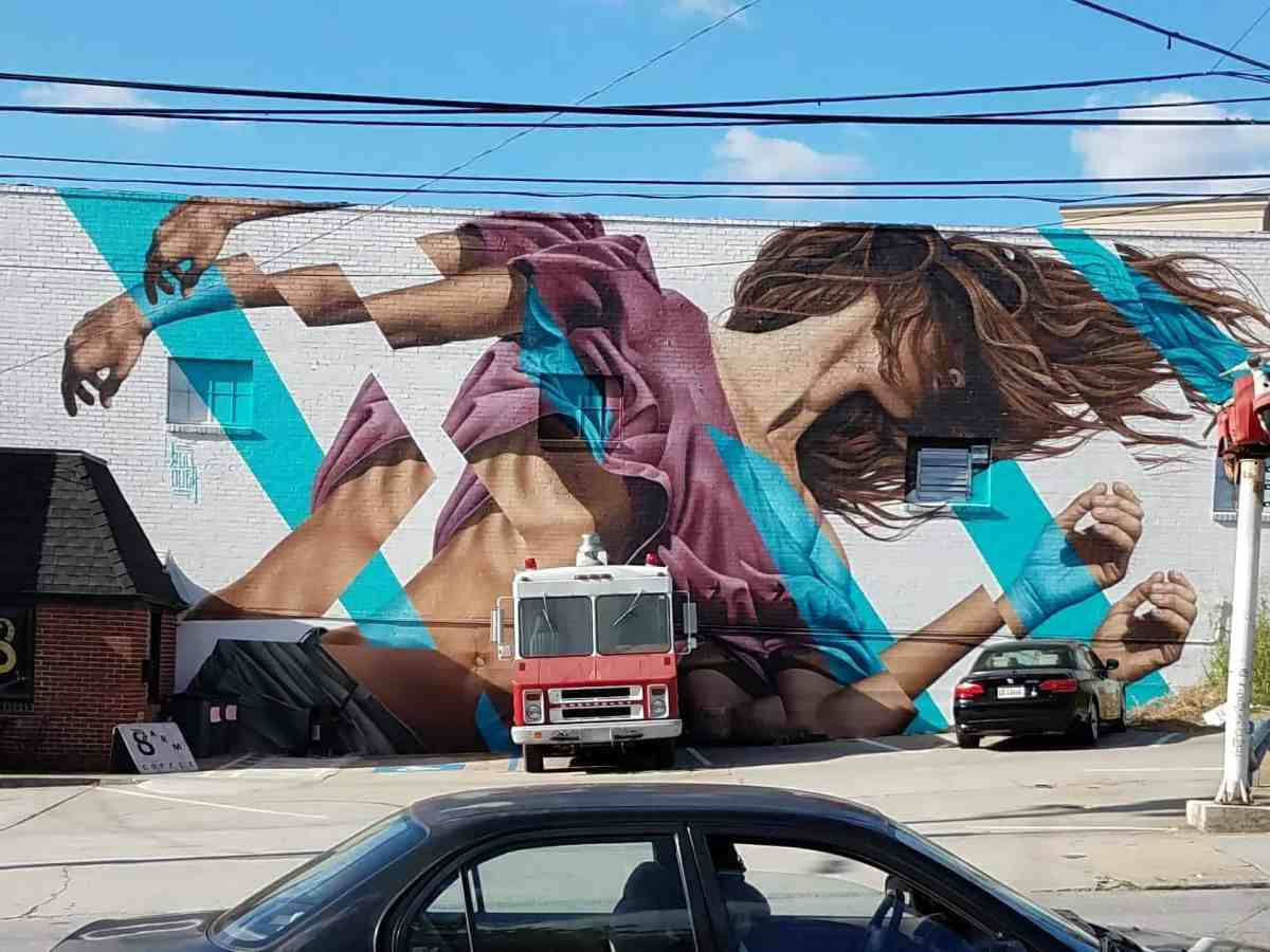 Building facade by artist James Bullough featuring a deconstructed image of a woman in Midtown