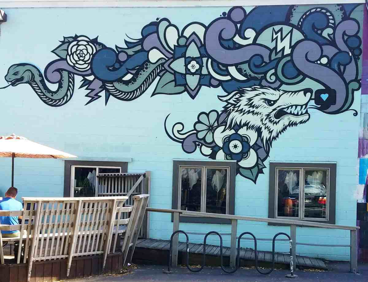 Street art featuring a wolf by artist Sam Parker in Litle Five Points