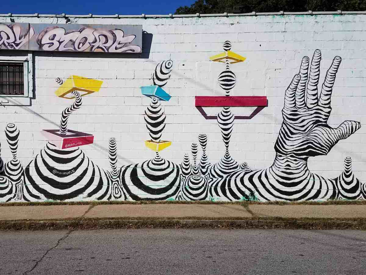Grafffiti featuring black andwhite striped images by artist Adam Pee in Old Fourth Ward Atlanta