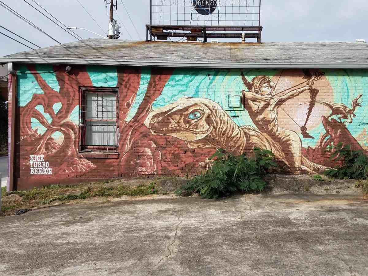 Mural featuring a dinosaur by artist Nick Turbo Benson in Inman Park