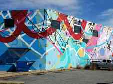 building facade with an abstract multi-colored pattern by artist Hense