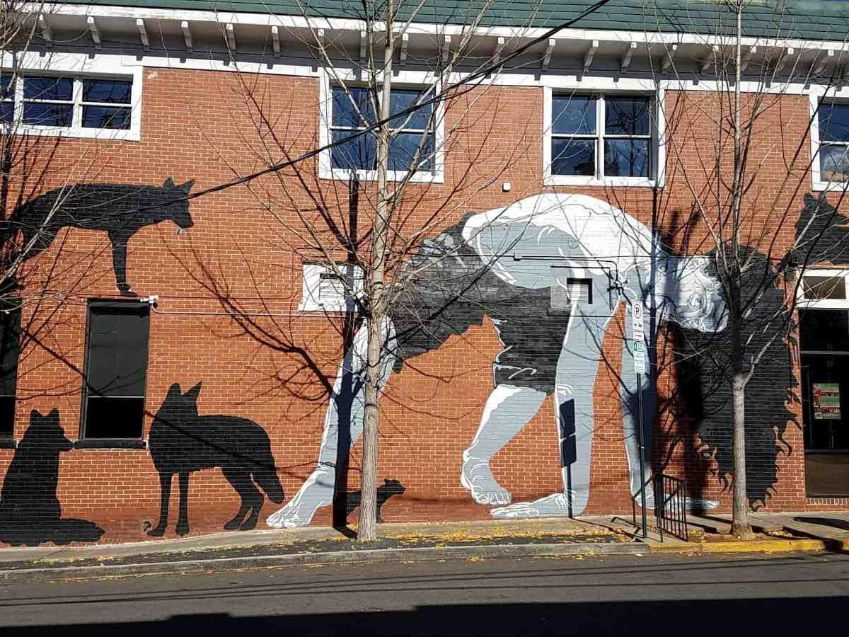 Graffiti of a person bending over in Virginia Highlands Atlanta