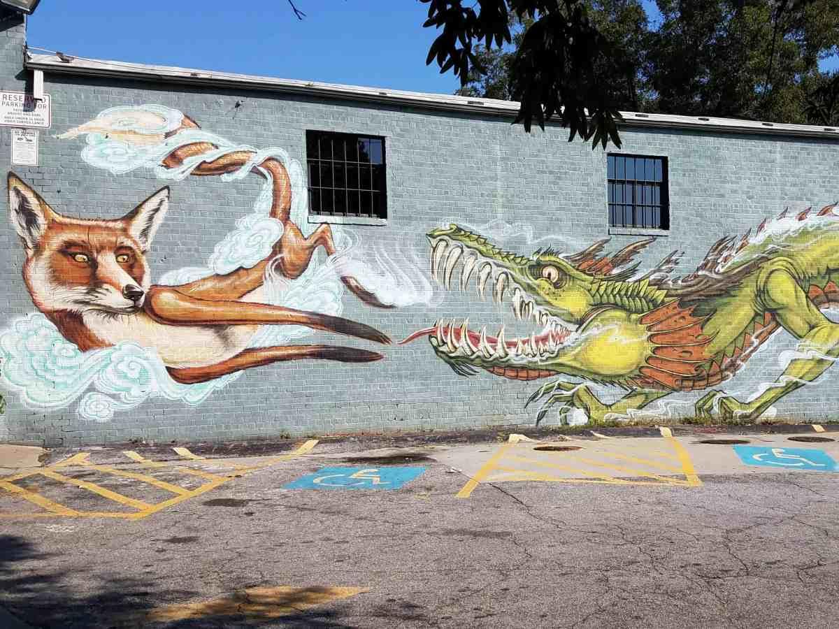Street art featuring a dragon and a fox by artist Shaun Thurston in East Atlanta