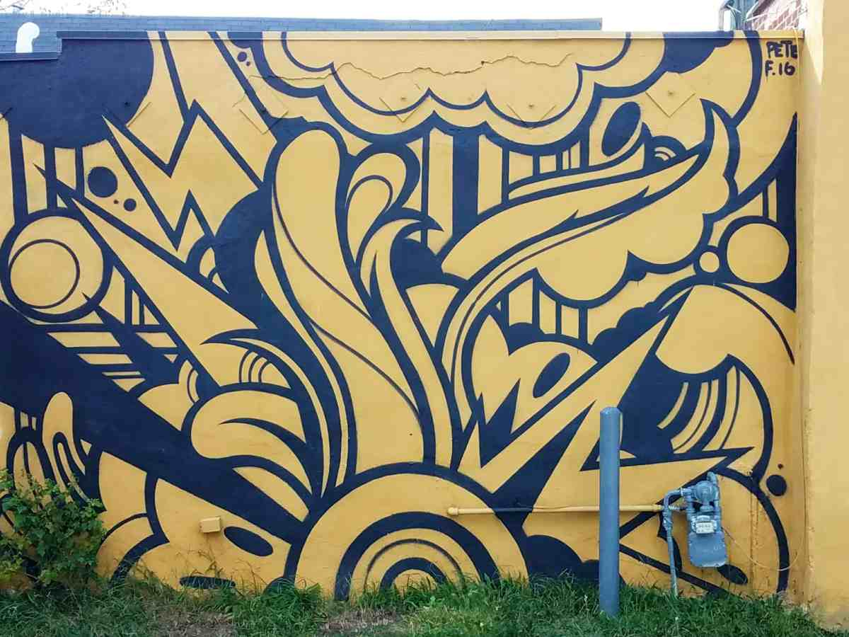 street art featuring a black and yellow abstract pattern by artist Peter Ferrari in Cabbagetown