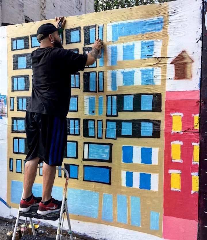 ralph serrano paints Resisting Gentrification, Rezoning and Displacement in East Harlem with The Harlem Art Collective at the Guerrilla Gallery