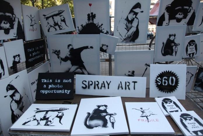 Banksy selling Banksy canvases in Central Park