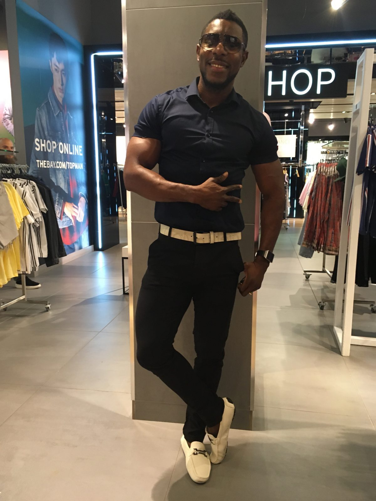 African origin man in Miss ssiauga wearing navy blue short denim jeans loafers