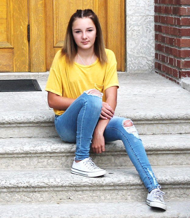 blong girl in yellow shirt on concrete steps forlorn emotion airdrie alberta church