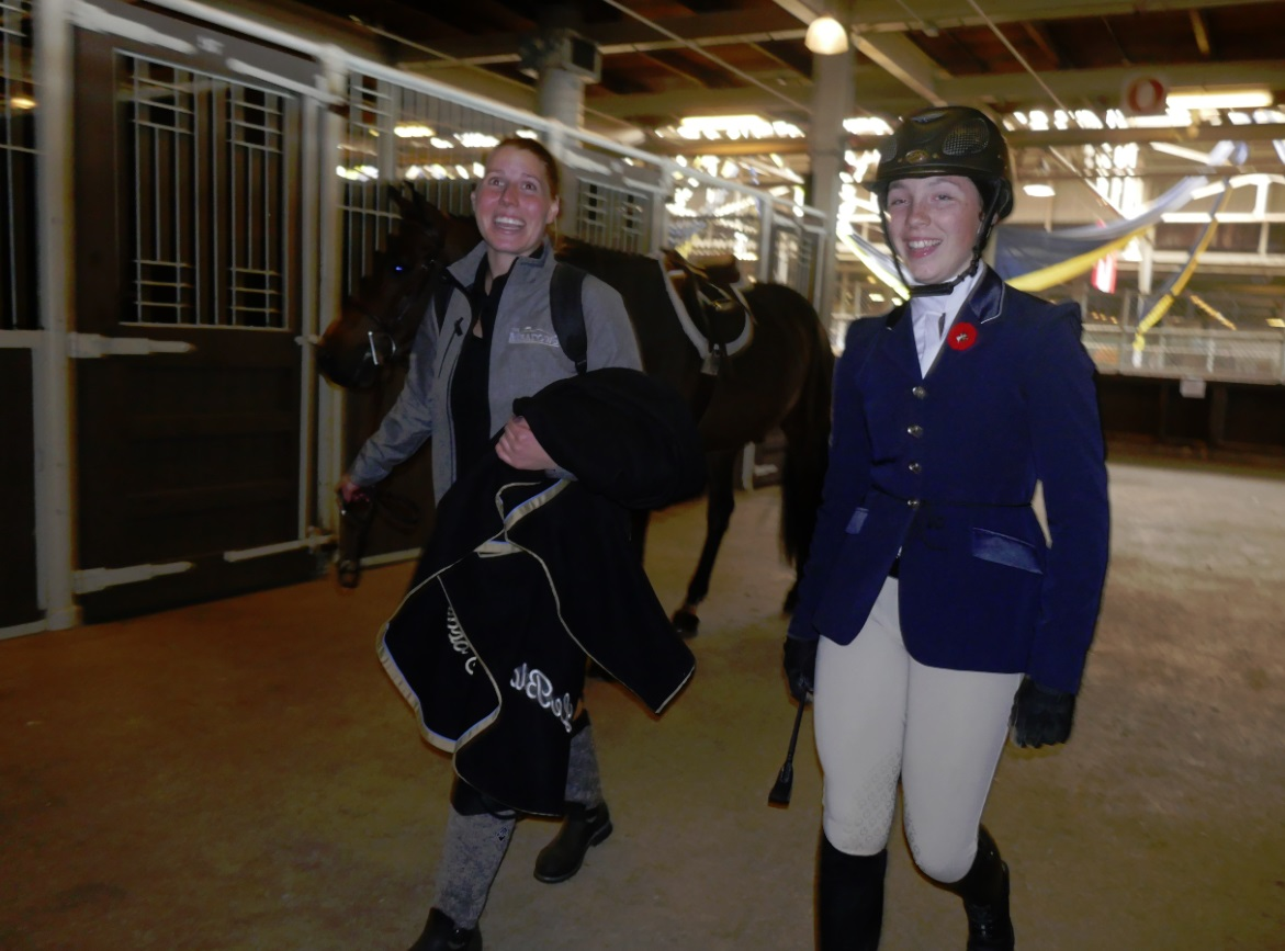 rider coats and boots at The Horse Show