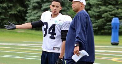 Northern Secondary School alum Eric Black chats with Toronto Argonauts coach Scott Milanovich