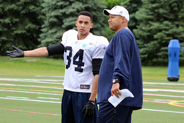 Northern Secondary School alum Eric Black chats with Toronto Argonauts coach Scott Milanovich
