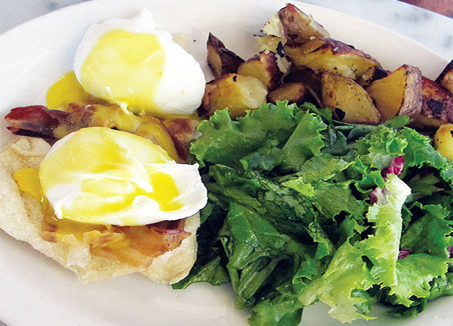 GREAT EGGSPECTATIONS: Savoury Eggs Benedetto, served up at midtown brunch diner, Lil' Baci.