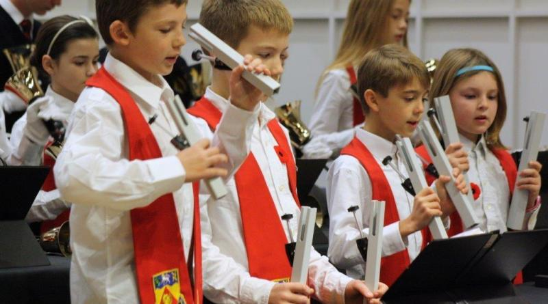 Youth playing hand chimes