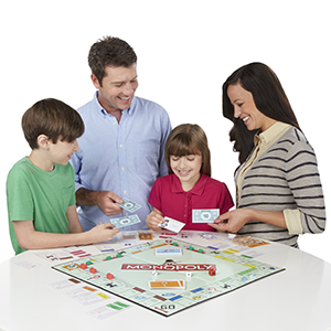 Family plays Monopoly