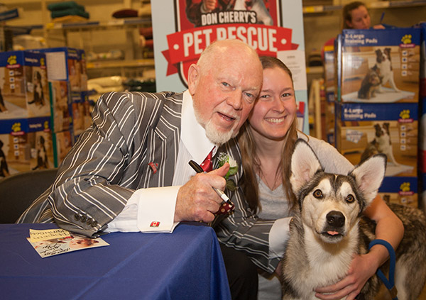 Midtown resident Pamela brings her dog Loki to get the thumbs up from hockey broadcaster Don Cherry at PetSmart. Cherry was at the Laird and Eglinton store The two legends were together Thursday at the PetSmart at Laird and Eglinton in Leaside to promote a Simply Pets dog treat in support of the Don Cherry Pet Rescue Foundation.