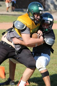 TUMBLIN' DOWN: Daniel Popa, left, is taken down by teammate Andrew Alvarado during a Leaside Lancers practice, Sept. 17.
