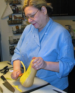 A-PEELING COOK: Sharon Ellson, known as the Spice Lady, at work in her kitchen.