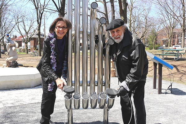 A LITTLE UP-TEMPO FOR THE TEMBO: Sharon Hampson, left, and Bram Morrison play on one of the instruments they chose for the Music Garden at June Rowlands Park. The garden will be opened May 14.