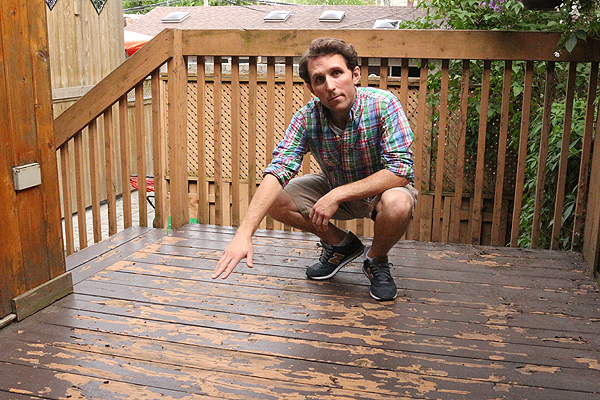 Dan Pero points to peeling deck paint