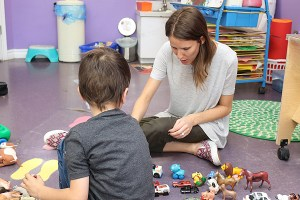 LESLIE CERESNE, a kindergarten teacher at Yes I Can, plays with one preschooler who has autism.