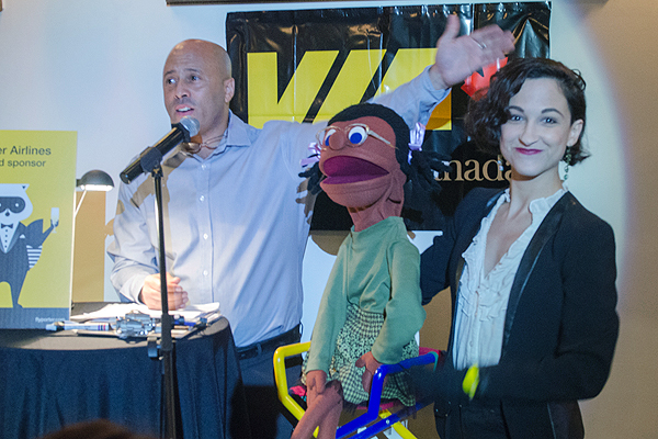 """HIGHEST BIDDER: Douglas Hurst, left, and Courtney Lamanna take to the microphone during their second annual """"Chair""""-ish the Kids Mix and Mingle Fundraiser."""