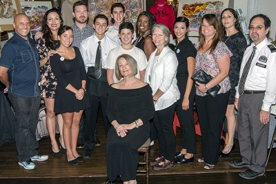 """VOLUNTEERS from the """"Chair""""-ish the Kids Mix and Mingle Fundraiser gather for a final group shot after the event, Sept. 22."""