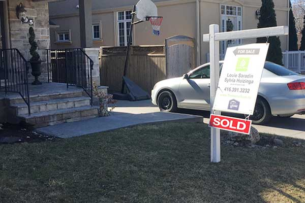 Sold sign outside house