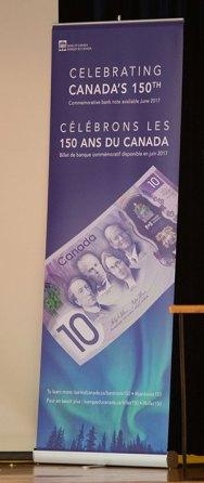 New $10 bill shown.