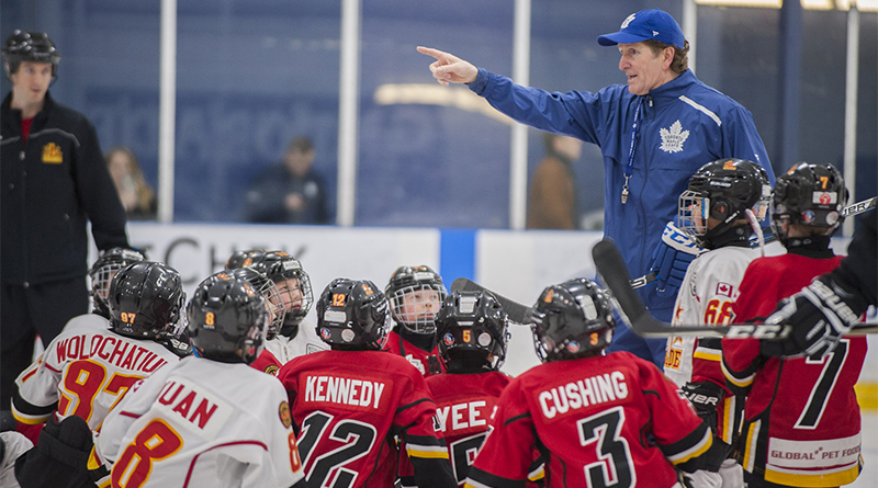 Maple Leafs coach runs Leaside Flames through their drills